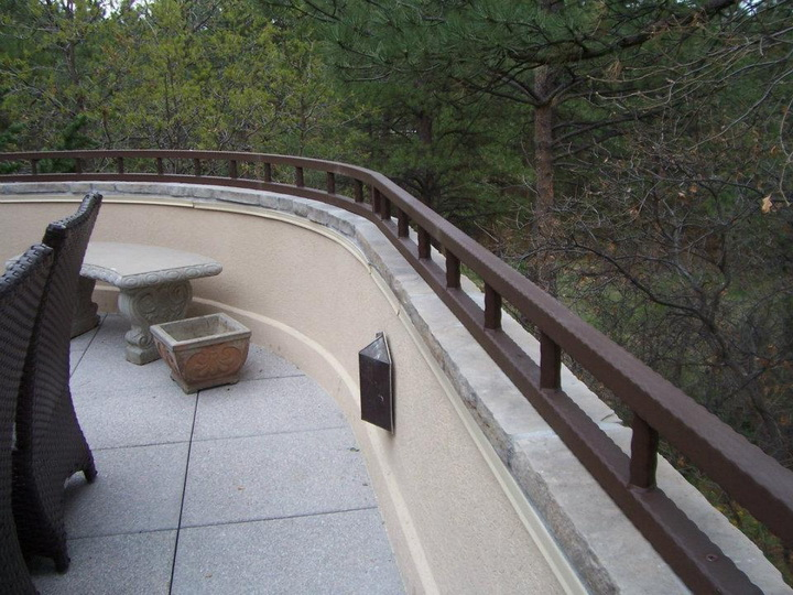 deckrailings26 - Custom hammered wall top railing.
